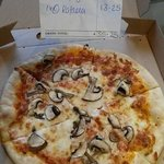 Al funghi (mushroom) pizza with hardly any mushroom costing a whooping tenner. 75p more and u co
