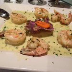 Sautéed shrimp in garlic & oil finished in a creamy parsley pesto cream sauc