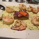 Sautéed shrimp in garlic & oil finished in a creamy parsley pesto cream sauc