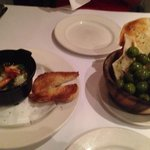 Garlic prawns and warm olives.