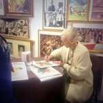 Ruth Skelllie signing prints for happy customers!