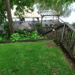 Looking down from back porch to pier over river.