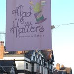 The hanging sign for Mad Hatters Tearoom