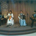 A live performance of traditional Kazakh music delights diners.