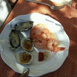 Poached prawns, smoked clams, the freshest oysters on a half shell