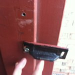 The broken latch on front left side entrance.