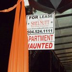 Haunted Apartment for Rent sign