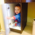 Playing in the vanity cupboards :)
