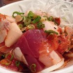 Hawaiian Poki Salad - hawaiian-style spicy assorted sashimi salad.  $11 Delicately seasoned -