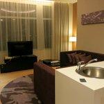 1 bedroom condo living room / edge of kitchen