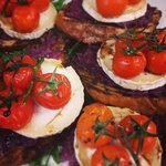 Warm bruschetta of sweet red onion jam, grilled goats cheese, vine roasted tomatoes