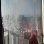 dirty glass door ...cannot see out to little balcony