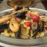 Homemade pasta with seafood.