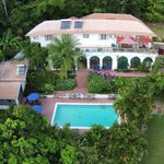 wide aerial of main villa nd pool house