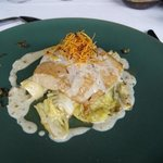 pescado on a bed of spinach and cabbage