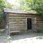 Historic Ogle Log Cabin facing the Parkway in DOWNTOWN Gatlinburg