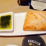 Fresh crusty bread with seasoned olive oil dip