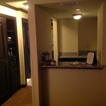 Wet bar area with sink and fridge