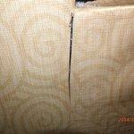 peeling moldy wall paper by window