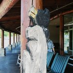 Carved wooden black bears are climbing the support beams