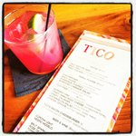 Hibiscus margarita and happy hour menu