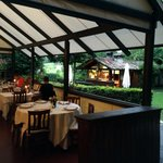 Inside Tre Camini with view of out door dining and view of forno in the giardino