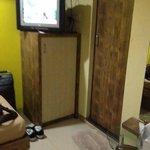 Area in front of beds (bathroom door & dirty mat)