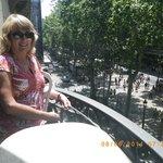 My wife enjoying the view of activities on La Rambla!
