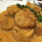 A superb creamy disks of tofu in a mildly spicy sauce.