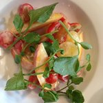 Peach and tomato salad with buttermilk dressing.