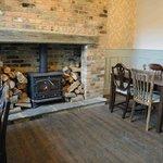 Enjoy a drink alongside our cosy fireplace