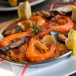 Enjoying Paella at our Spanish restaurant El Quijote