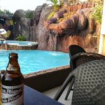 Having a beer by the pool
