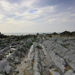 Rock ridges running out to sea