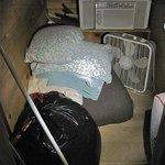 Storage closet with bedding on floor