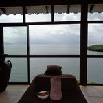 Massage room overlooking the water from the cliff