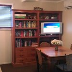 Dining, TV and a mountain of reading material!