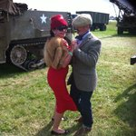 having a boogie woogie by the US Army 1940s trucks