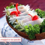 Grilled fish wrapped in rice pancake