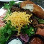 taco salad with a warm spicy bun