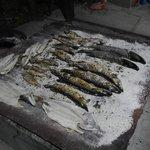 Pike baked in salt on a board.