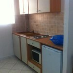 Handy Kitchen area. Fridge is useful for water