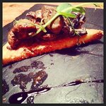 Devilled lamb with pickled mushrooms and pea shoots.