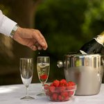 Garden Lounge serving Champagne to a couple celebrating their anniversary