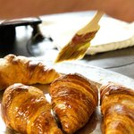 Delicious croissants being prepared for breakfast