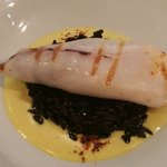 Squid stuffed with ham on black risotto