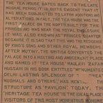 A plaque providing information about the tea house
