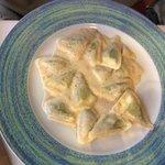pesto ravioli with walnut sauce