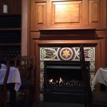 Fireplace by the table. Warmth and atmosphere in union.