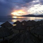 Sunset and beach cabanas at the Samba